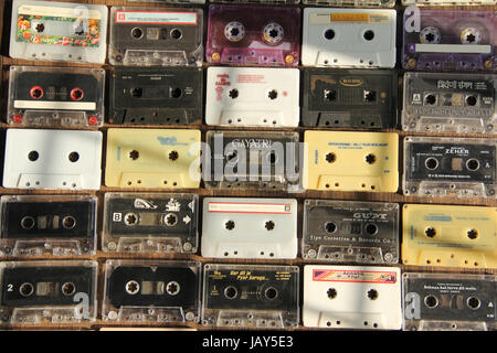 Top view of audio cassettes arranged in rows and columns - Stock Photo