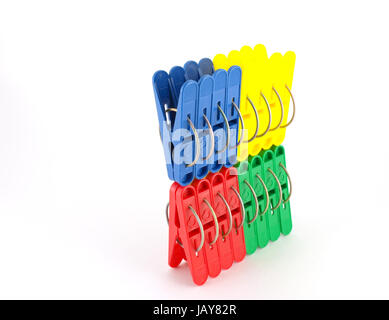Set of color clothes-pegs over white - Stock Photo