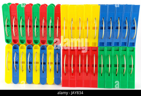 Color clothes-pegs over white - Stock Photo