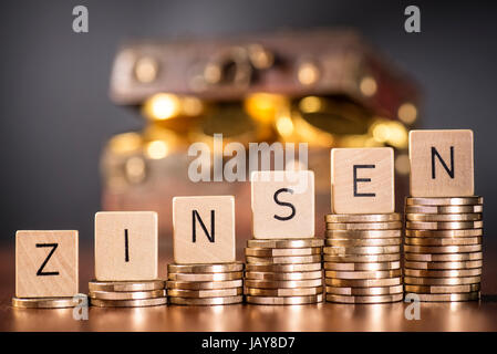 Stack of coins and the word interest. - Stock Photo