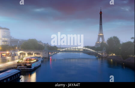 Early morning on river Seine with the view on Eiffel Tower in Paris, France - Stock Photo