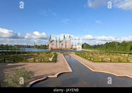The Frederiksborg Castle in Dutch Renaissance style and the baroque garden and the water Cascade canal in Hillerød - Stock Photo