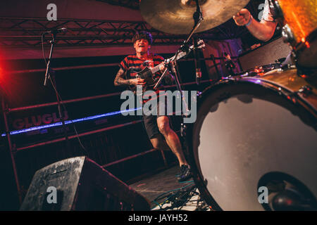 American garage rock band Thee Oh Sees performs live at Magnolia in Milan. - Stock Photo