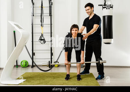 Man and woman working out together EMS training closeup, power pose - Stock Photo
