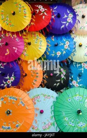 Umbrellas on sale at market, Mingun, Mandalay, Myanmar - Stock Photo