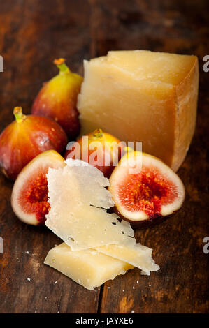 italian pecorino cheese and fresh figs macro closeup over old wood boards - Stock Photo