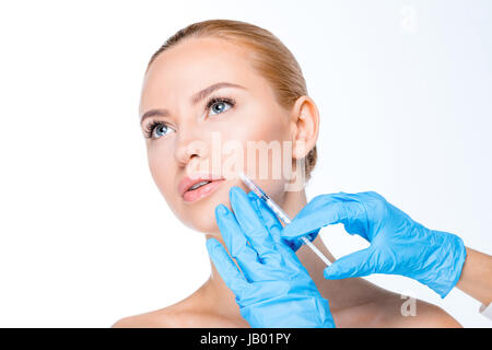portrait of woman getting botox injection on white - Stock Photo