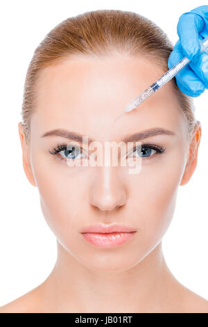 portrait of woman getting botox injection and looking to camera on white - Stock Photo