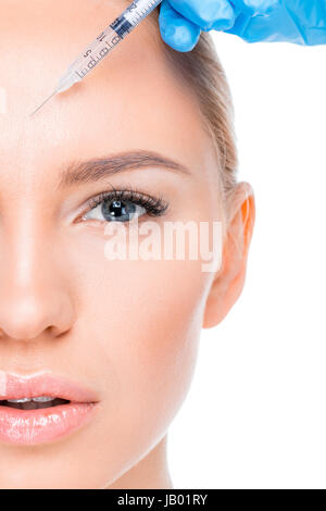 partial view of woman getting botox injection on white - Stock Photo