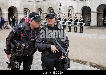 London, UK. 8th June, 2017. Armed London Metroplitain Police on duty at Horse Guards Parade, Whitehall in central - Stock Photo