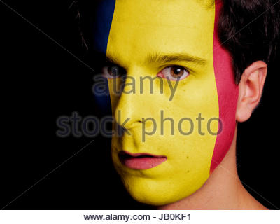 Flag of Chad Painted on a Face of a Young Man - Stock Photo