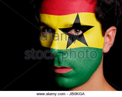 Flag of Ghana Painted on a Face of a Young Man - Stock Photo