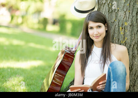 Festival woman with guitar at party - Stock Photo