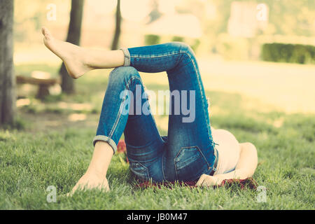 Relaxing woman in park - Stock Photo