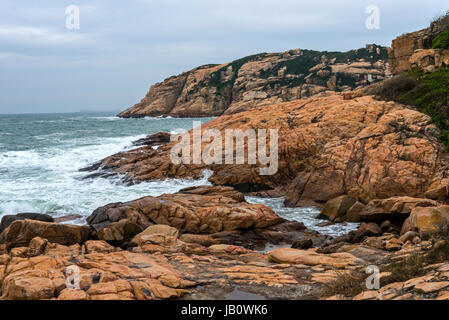 Rocky Coastline, Shek-O, South China Sea, Hong Kong - Stock Photo