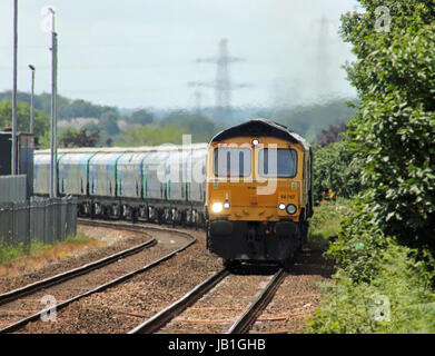 Cw 3061 66742 approaches Lostock Gralam on the 11.23 Bio mass train from Liverpool docks to Drax power station. - Stock Photo