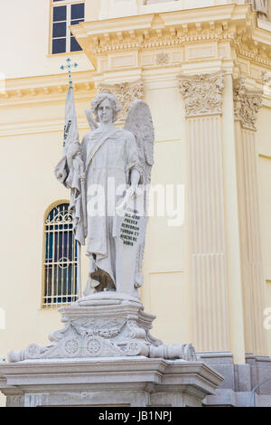 Roman sculpture, statue in front of the facade of a church - Stock Photo