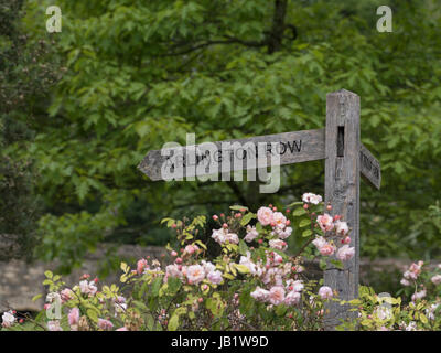 Close up view of Arlington Row sign in Cotswolds village of Bibury, Gloucestershire, United Kingdom - Stock Photo