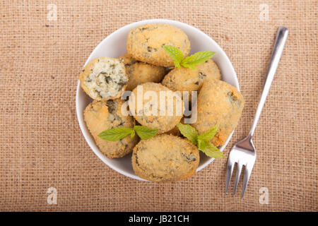 a handful homemade croquettes of spinach typical Spanish dish - Stock Photo