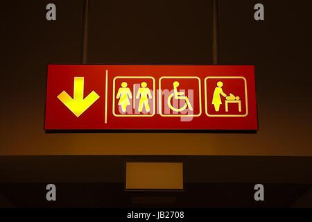 Toilets sign in a building corridor - Stock Photo