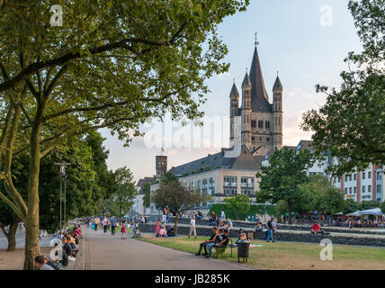 Great Saint Martin Church (Groß Sankt Martin) in the eary evening from the banks of the River Rhine, Cologne, Germany - Stock Photo