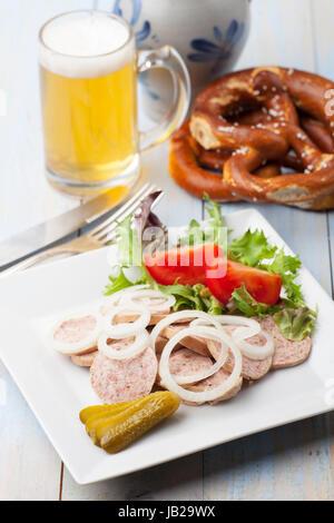 portion of bavarian sausage salad - Stock Photo