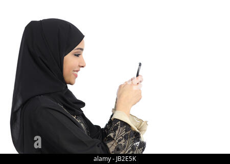 Profile of an arab saudi woman using a smart phone isolated on a white background - Stock Photo
