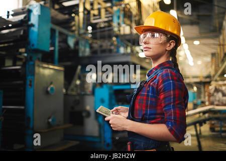 Female Employee Doing Checklist - Stock Photo