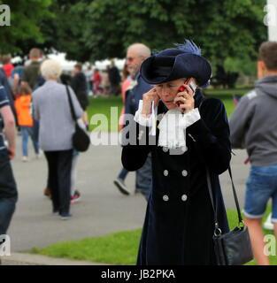 Beaulieu, Hampshire, UK - May 29 2017: High Sheriff of Hampshire the Hon Mrs Mary Montagu-Scott on her mobile phone - Stock Photo