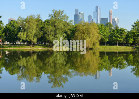 Novodevichye ponds on background of city skyscrapers. Moscow, Russia. Summer - Stock Photo