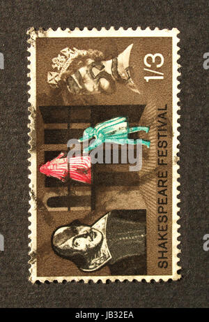 LONDON, UK - SEPTEMBER 19, 2009: British postage stamp with William Shakespeare and HM The Queen Elizabeth II - Stock Photo