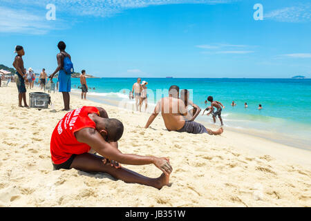 RIO DE JANEIRO - FEBRUARY 05, 2017: Muscular young carioca Brazilian lifeguard does his morning fitness routine - Stock Photo