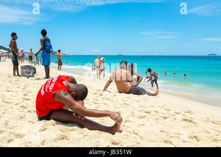 RIO DE JANEIRO - FEBRUARY 05, 2017: Muscular young carioca Brazilian lifeguard does his morning fitness routine - Stock Photo