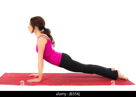 Young woman doing Upward Facing Dog in Yoga (Series with the same model available - Stock Photo