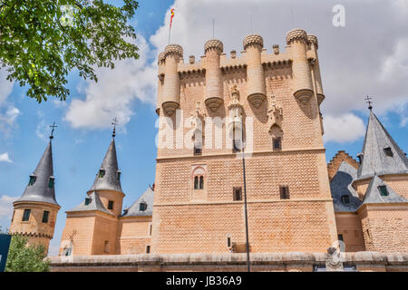 Segovia, SPAIN - June 3: Partial view of the Castle from the entrance to the monument and drawbridge, Juan II Tower, - Stock Photo