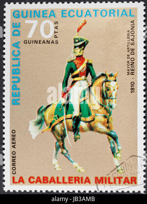 REPUBLIC OF EQUATORIAL GUINEA Guinea - CIRCA 1976: A postage stamp printed in the Equatorial Guinea shows army uniform - Stock Photo