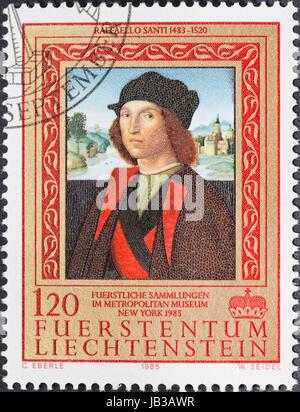 LIECHTENSTEIN - CIRCA 1985: A postage stamp printed in the Liechtenstein shows portrait of man by Raffaello Santi - Stock Photo