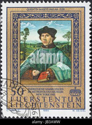 LIECHTENSTEIN - CIRCA 1985: postage stamp printed in the Liechtenstein shows Portrait of a Canon by Quentin Massys - Stock Photo