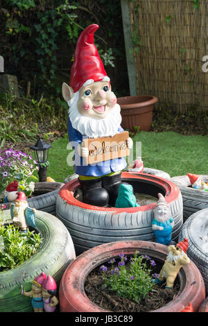Garden gnome with welcome sign, Overton, Hampshire, England, United Kingdom - Stock Photo