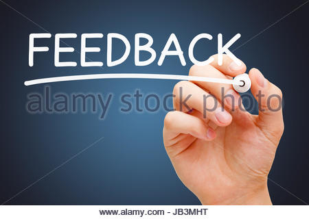 Hand writing Feedback with white marker on transparent wipe board. - Stock Photo