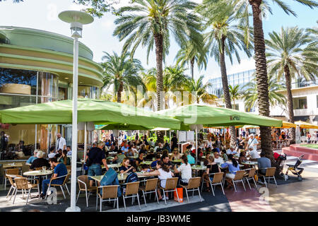 Miami Beach Florida Lincoln Road pedestrian mall Nexxt Cafe restaurant outdoor dining al fresco umbrellas crowded - Stock Photo