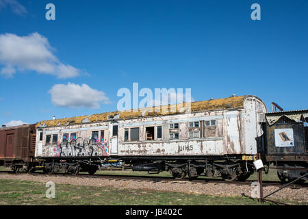 Old Railway Carriage Rolling Stock on a Siding. - Stock Photo