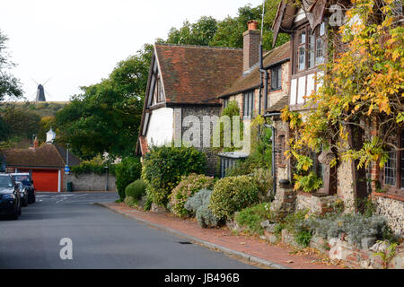 Village of Rottingdean near Brighton in East Sussex. England. With windmill in distance - Stock Photo
