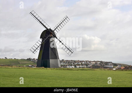 Windmill on cliffs above village of Rottingdean near Brighton in East Sussex. England. - Stock Photo