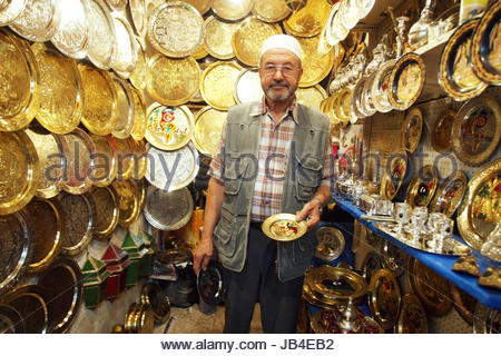 Tunis,Tunisia - September 14th, 2012 : Seller of traditional carved plates that are sold as souvenirs at one of - Stock Photo