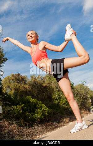 young attractive athletic woman stretching fitness outdoor summer - Stock Photo