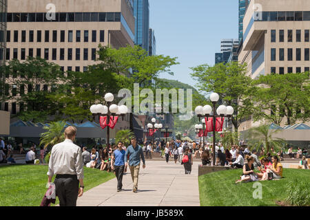 Montreal, CANADA - 8 June 2017: Place Ville Marie esplanade and Mount Royal in the background - Stock Photo