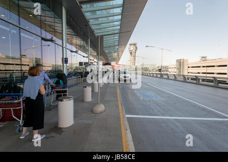 Montreal, CANADA - 8 June 2017: Passengers waiting for a taxi at Pierre Elliott Trudeau International Airport - Stock Photo