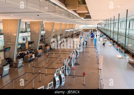 Montreal, CANADA - 8 June 2017: Check-in counters at Pierre Elliott Trudeau International airport. - Stock Photo