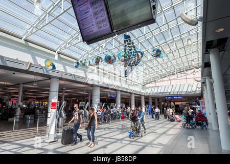 Montreal, CANADA - 8 June 2017: Passengers walking to departure gate at Pierre Elliott Trudeau International Airport - Stock Photo